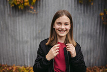 Portrait Of Vibrant Young Girl Outside In City.