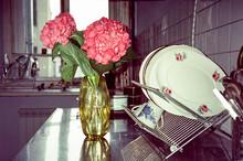 Hydrangea Pink Flower In A Vintage Yellow Vase In The Kitchen
