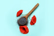 Leinwandbild Motiv Spoon with poppy seeds and flowers on color background