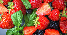 Fresh Summer Berries, Strawberries And Blackberries With Leaves Close-up