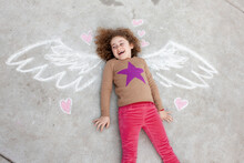 Girl With Drawn In Angel Wings Behind Her