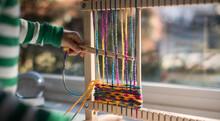 Child Weaving On Loom
