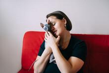 Adult Woman Hugging Little Cat