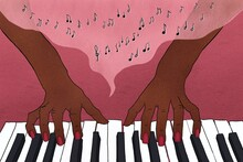 Pianists Fingers On Piano Keys