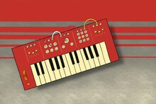 Red And Cream Synthesizer Keyboard