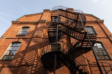 Red Brick Building With A Metal Stairs In It's Facade