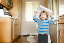 Toddler Plays With Unfurled Paper Towels