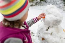 Girl Makes Snowman Face