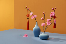 Spring Peach Flowers Blooming In Vase Isolated On Color With Lucky Knot