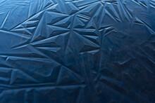 Blue Ice Shapes On A Frozen Pond