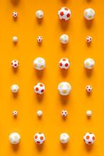 Soccer Balls On Orange Background