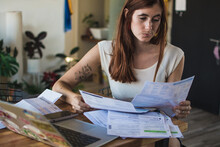 Woman Struggling With Debts To Pay
