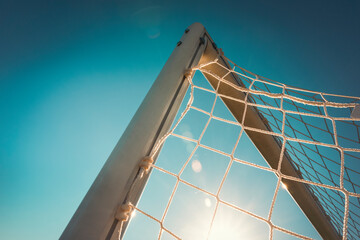 Top corner of a football goal in the sunset