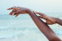 Hands With Accessories On A Beach