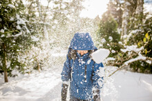Boy Ducks Head In Shower Of Snow