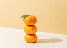 Stack Of Mandarin Oranges With Leaf