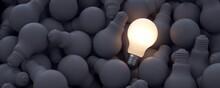 Big Ideas. Illuminated Light Bulb Among The Rest Of The Unlit Bulbs.