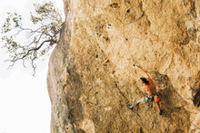 Climber In Safety Harness Climbing Mountain