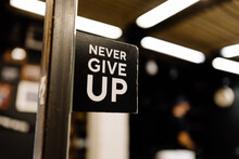 """Lettering """"Never Give Up"""""""