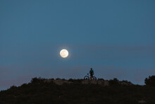 Cyclist To The Full Moon