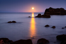 Long Exposure On The Coast With A Full Moon.