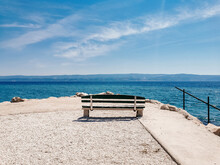 Minimalist Image Of Empty Sea Bench On Sea Shore On A Sunny Day In Summer.