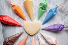 Heart Cookie With Multicolored Frosting Bags
