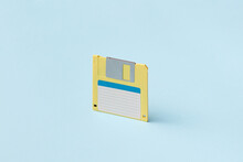 Yellow Floppy Disc On Light Blue Background