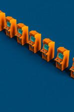 7 Orange Arcade Cabinet On Blue Background Arranged