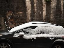 Fresh Snow On Black Car