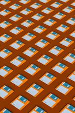 Blue And Orange Floppy Disks On Brown Background