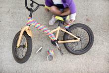 Girl With Taped Rainbow Bike