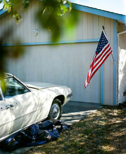 Vintage Car And Flag In An American Driveway