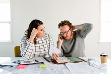 Couple Calls Their Bank To Discuss A Faulty Expense Charge Made To Their Account