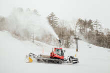 Grooming And Snowmaking Machines Operating At A Ski Resort In New England