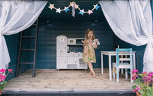 Little Girl In Tree House Play Kitchen