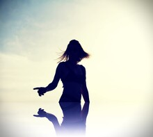 Silhouette Of A Woman In Motion, With Reflection. Shot Of A Fashioned Short Hair Model While Moviing .