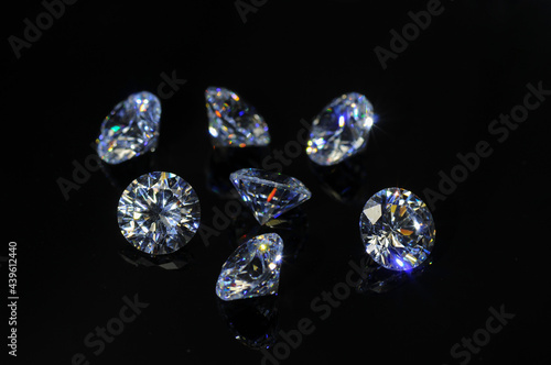 Fotografie, Obraz Round diamond faceted cubic zirconia set lot, cubic crystalline form of zirconium dioxide (ZrO2) colorless synthesized material