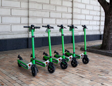 Electric Scooter Rental In City Center. Scooter Sharing For Tourists And Citizens. Using Sharing App.