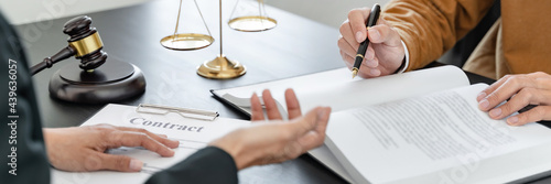 Fotografie, Obraz Lawyer with lawsuit meeting with client discussing with contract agreement at courtroom