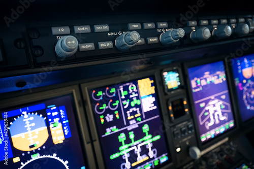 Tela A typical dashboard panel in the cockpit of a private jet plane aircraft