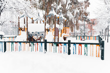 Playground Covered With Snow In Winter