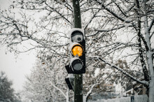 Traffic Light On Streetlamp In City