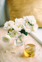 White Roses In A Vase And Green Tea