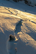 Crevasse On Jungfraufirn Glacier In Golden Light