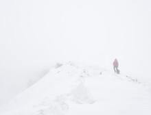 Walking In Heavy Snow On Wild Boar Fell, Cumbria, UK.