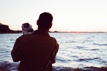 Man With Cat At The Lake