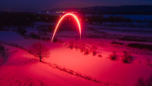 Long Exposure Of A Red Firework At Night