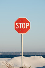 Red Stop Sign At The Beach