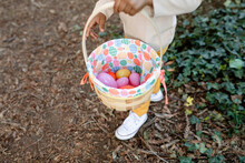 Close Up Of A Young Boy's Colorful Easter Basket Filled With Colorful Easter Eggs